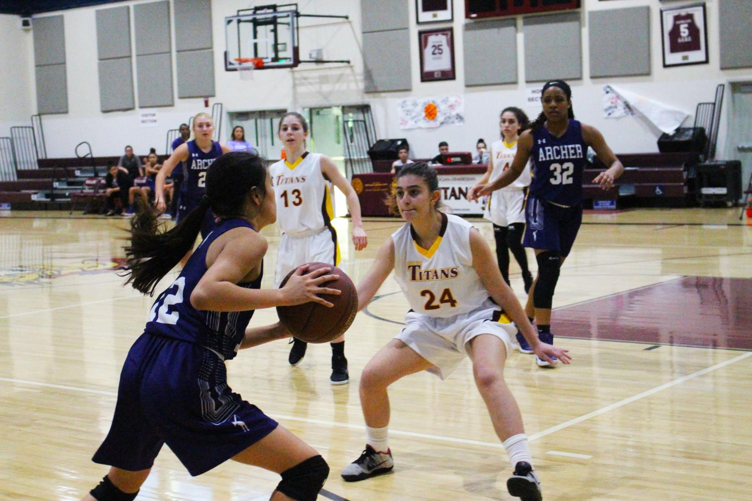 Co-captain Caitlin Chen '19 attempts to pass the ball during a previous game at AGBU on Jan. 18. Archer finished their season with a 16-12 record.
