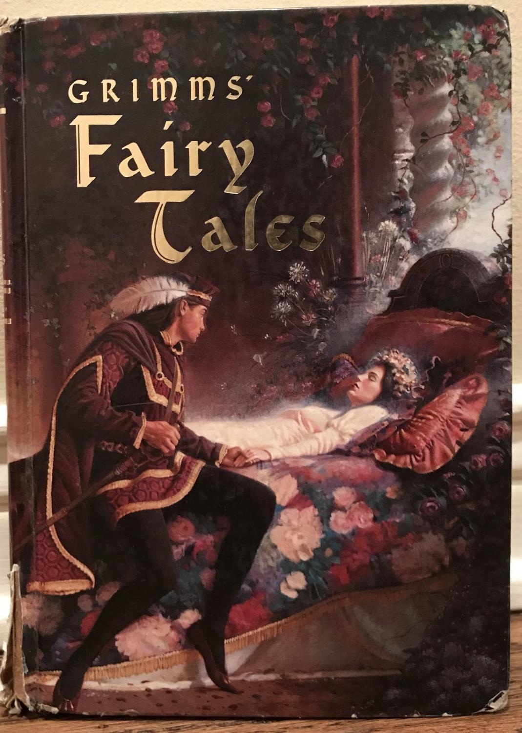 My copy of Grimms' Fairy Tales. My elementary school allowed me to keep this copy because it was falling apart.