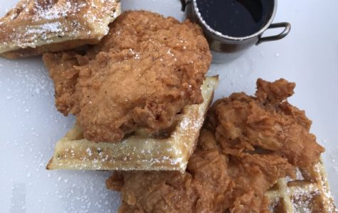 My delicious dinner consisting of a deep-fried chicken breast and delicious rosemary waffle covered in powered sugar. Soho Chicken and Whiskey is located in Cleveland, Ohio.
