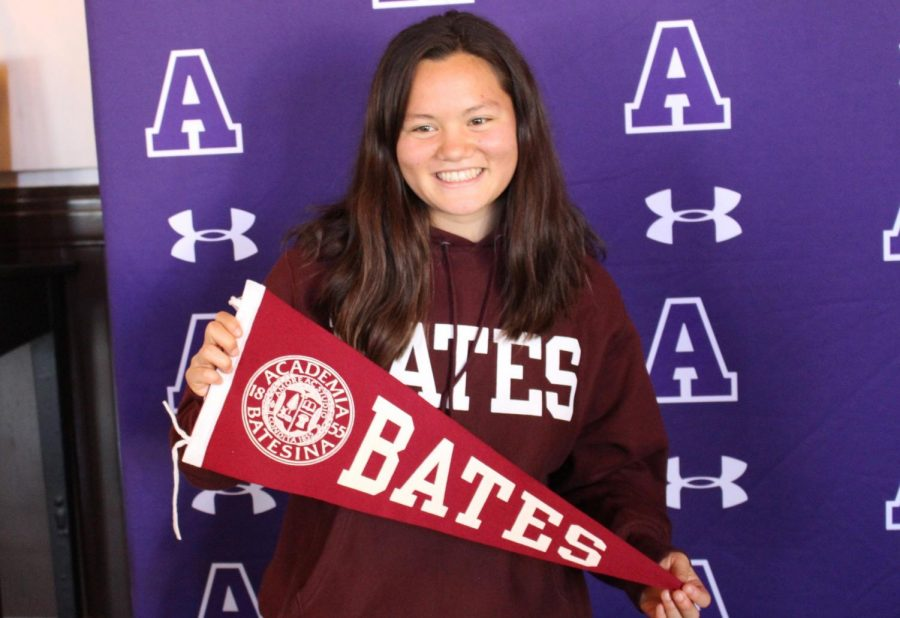 Saskia Wong-Smith '18 poses for a photo with her Bates pennant after signing her National Letter of Intent. She is Archer's first swimmer to commit to swimming collegiately.