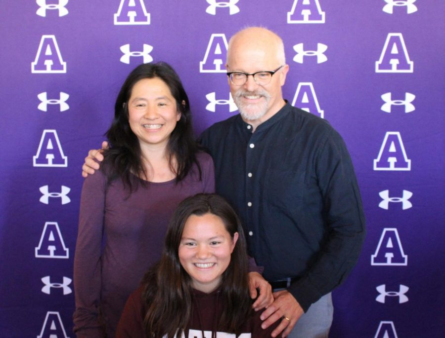 Wong-Smith and her parents pose for a photo during the NLI signing ceremony. She is the first Archer swimmer to go to swim on a collegiate level.