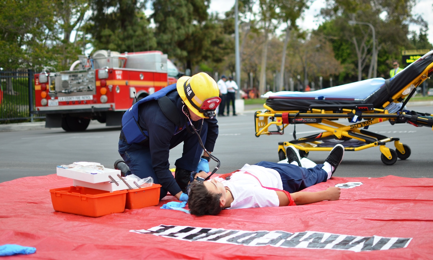 A LAFD firefighter treats a victim during a simulated school shooting drill. In order to prevent more school shootings, federal laws need to be created to limit access to firearms. Image source:  LA County Fire Department .