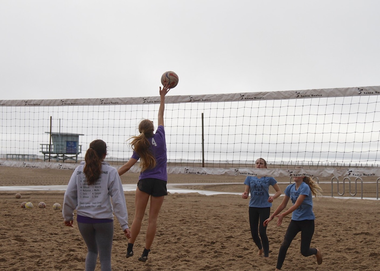 Gillian Varnum '20 hits during a beach volleyball tournament. She is currently a co-captain alongside Stella Smyth '19.