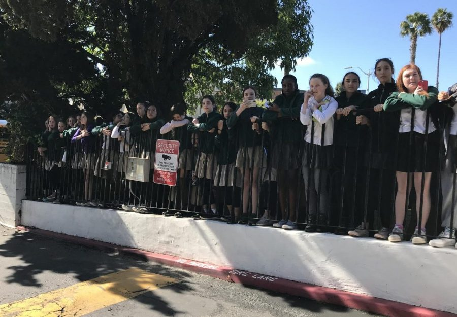 Middle+school+students+watch+from+the+front+gates+of+Archer+as+the+older+students+sped+off+of+campus+to+protest+in+the+streets.+The+protest+interrupted+Archer%27s+planned+ceremony.