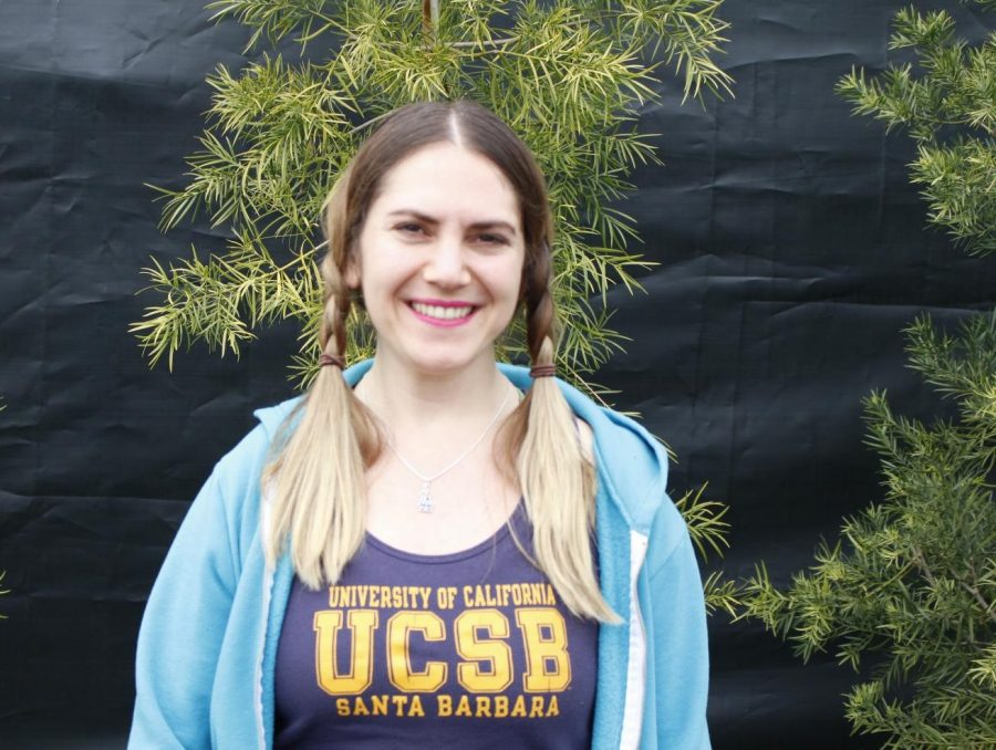 Jessica+Mkitarian%2C+a+seventh+grade+math+fellow%2C+poses+for+a+photo+during+Archer%27s+annual+Spirit+Week.+She+was+dressed+up+for+Spirit+Week%27s+Workout+Wednesday.+