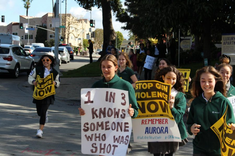 Sophomores+Betsy+Gaghan%2C+Beechie+Spiller%2C+Sydney+Cort+and+Zoe+Cort+run+toward+the+other+protesters.+According+to+Gaghan%27s+sign%2C+one+in+three+people+know+someone+who+has+been+shot.++