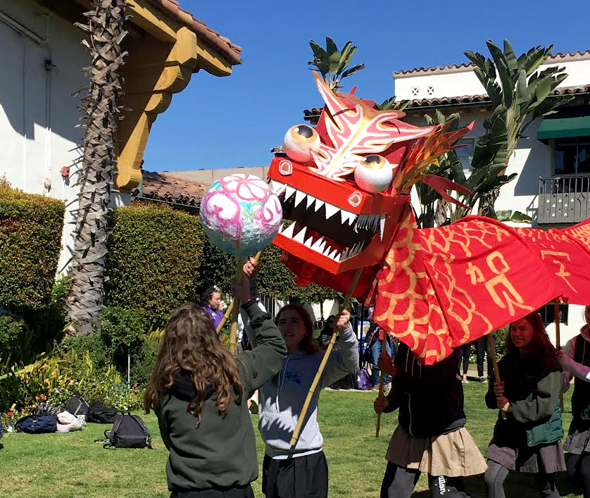 The Chinese 2 class performs the traditional dragon dance. The students made the dragon  in Archer's IDEA Lab.