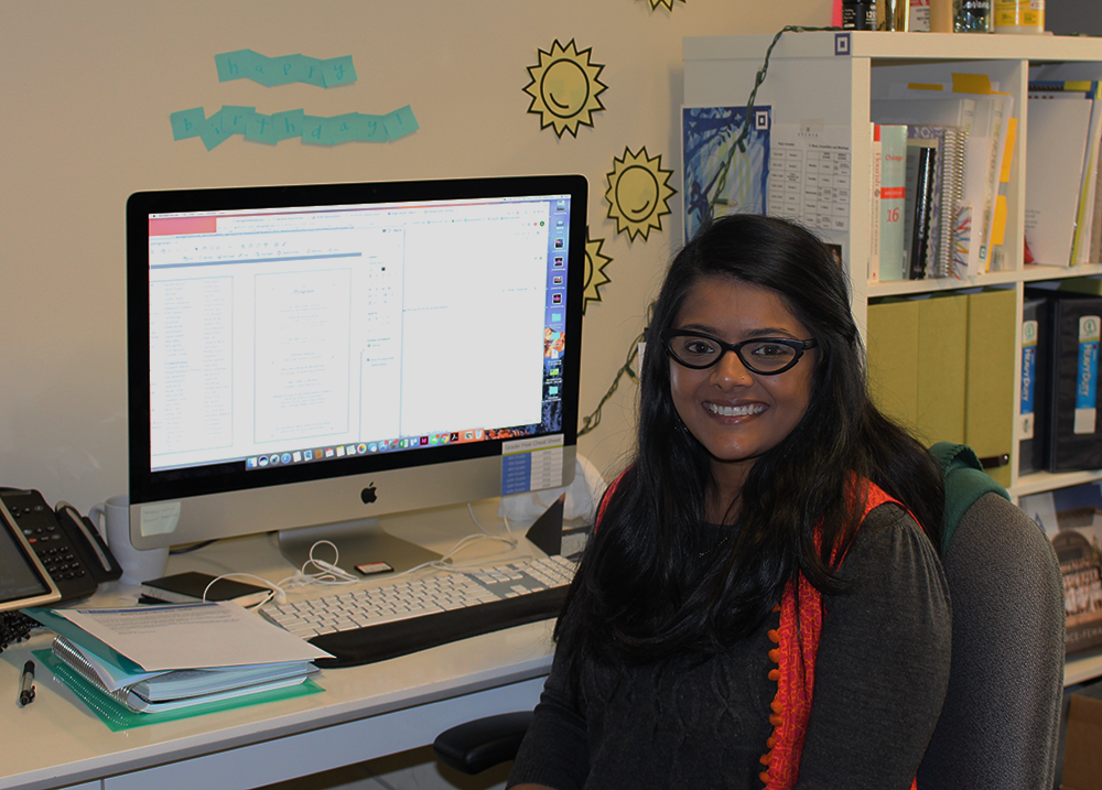 Avani Shah sits at her desk. When she is not sitting at her desk like she is here, Shah can be found taking photos around school,  or observing different classes to see what is going on around campus.  Archer is the second all-girls school that Shah has worked at.