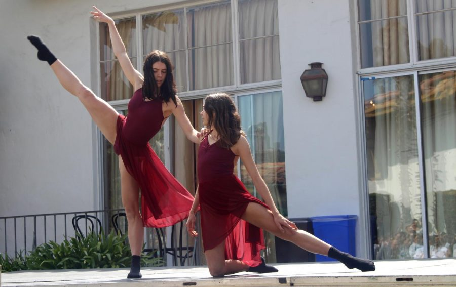 Sisters Cameron Thompson '18 and Kelsey Thompson '20 perform a duet in the Festival of Dance. The dance show took place on April 27.