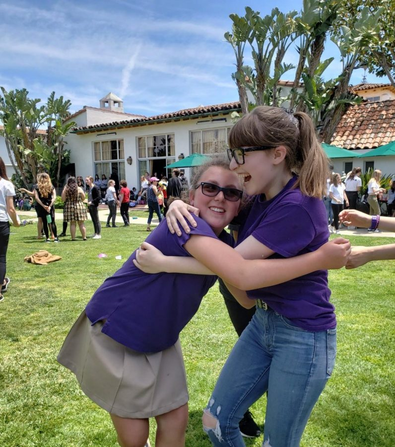 Stephanie Harrison '24 and Maya Wernick '18 hug during the relay race. As a senior, Wernick said she hopes to keep this memory after graduation.