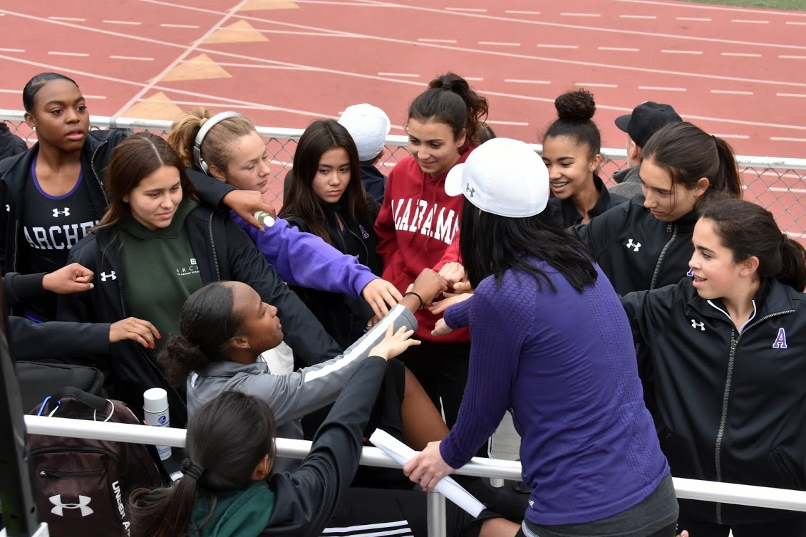 The Archer track team says a cheer before a meet begins. Members of the team will be competing in CIF prelims on May 12. Image courtesy of Alessandra Judaken '21.
