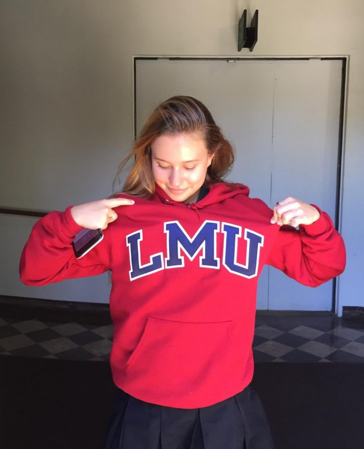 Regina Valitova '18 poses with her LMU sweatshirt. Valitova is among the seniors who plans to attend the school in the fall.