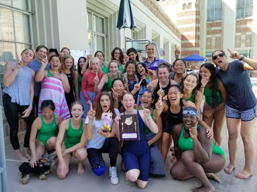 The+varsity+swim+team+poses+with+their+championship+trophy.+Some+swimmers+will+continue+on+to+compete+in+the+CIF+meet+on+May+11.+Image+courtesy+of+Summer+de+Vera.+