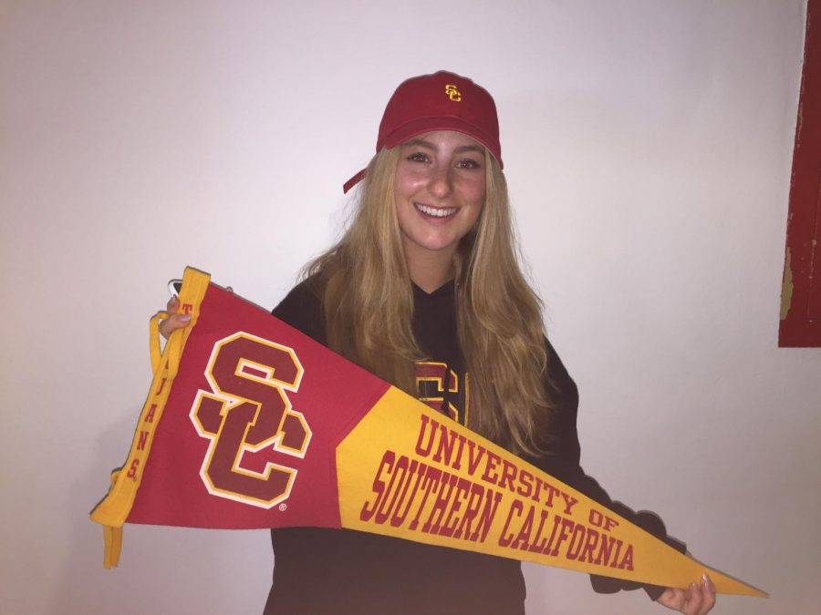 Gwen+Strasberg+%2718+holds+the+University+of+Southern+California+pennant+during+Archer%27s+National+College+Decision+Day+celebration.+May+1+marks+the+national++deadline+for+in-coming+college+students+to+finalize+their+decisions.+