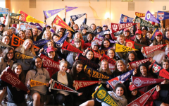 The Class of 2018 and Head of School Elizabeth English pose in the Rose Room with pennants. The seniors, along with Gwen Strasberg '19, participated in the pennant-hanging event.