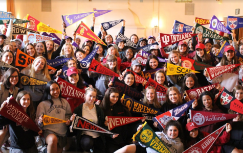 Students hang pennants on National College Decision Day