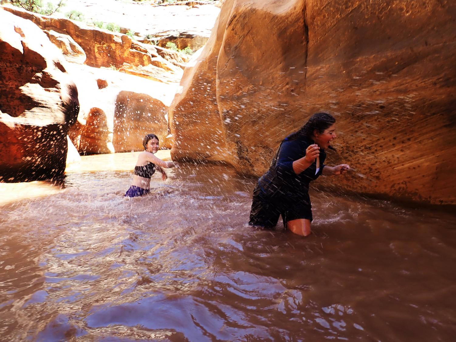 Seventh grade students Sofia D'Addario and Annabelle Terner splash in the water of a Utah canyon. This image won the photo competition.