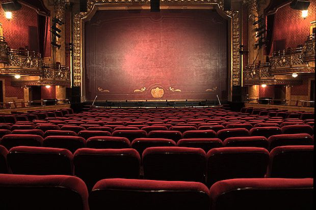 The interior of a movie theatre. Film teacher Steven Jacobson believes a movie theater, like this, is an ideal place to cry. Image source:  National Endowment for the Arts.