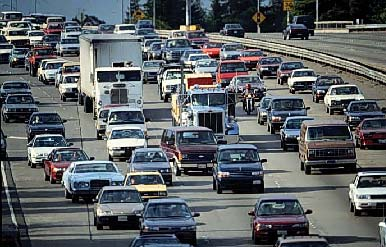 Vehicles drive on a freeway. Greenhouse gas emissions from cars contribute to air pollution and detrimental health. Photo courtesy of California Air Resources Board.