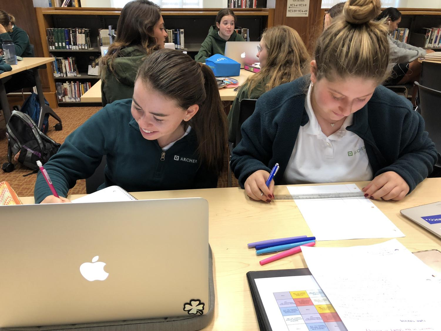 Arianna Miller and Julia Wanger '20 organize their notes to prepare for the year ahead.