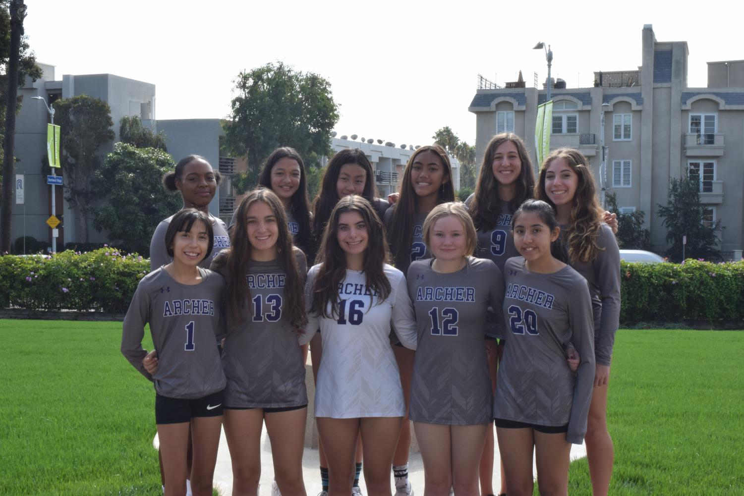 Giana Parks '21, Ali Aragon '22, Katelyn Chi'22, Faith Soriano '22, Arielle Janger '20, Emily Eshel '21, Andrea Ramirez '22, Mikayla Weinhouse '22, Zoe Berman '21, Amber Calvert-Jones'21 and Mikaela Foronda '22 pose for a photo in front of Archer. The team is open to all upper school students.