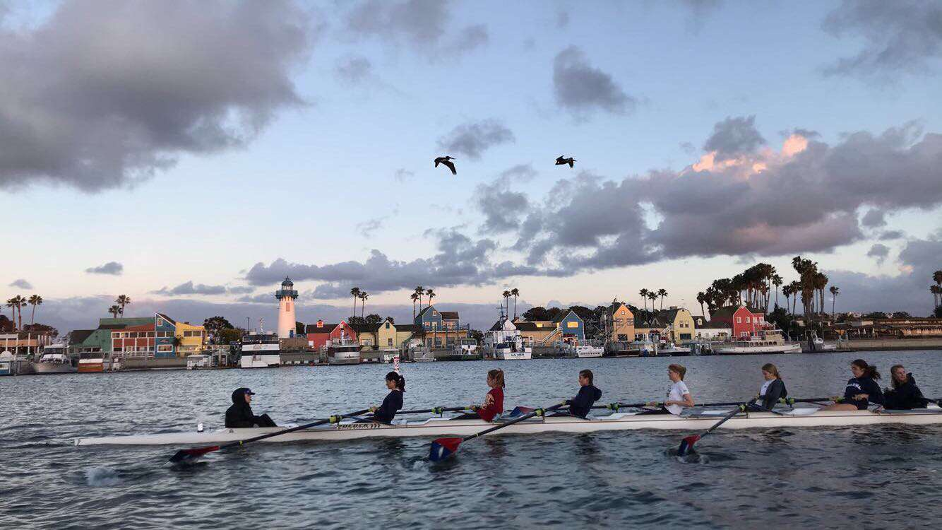 Griffiths leads a boat of rowers at practice one day.