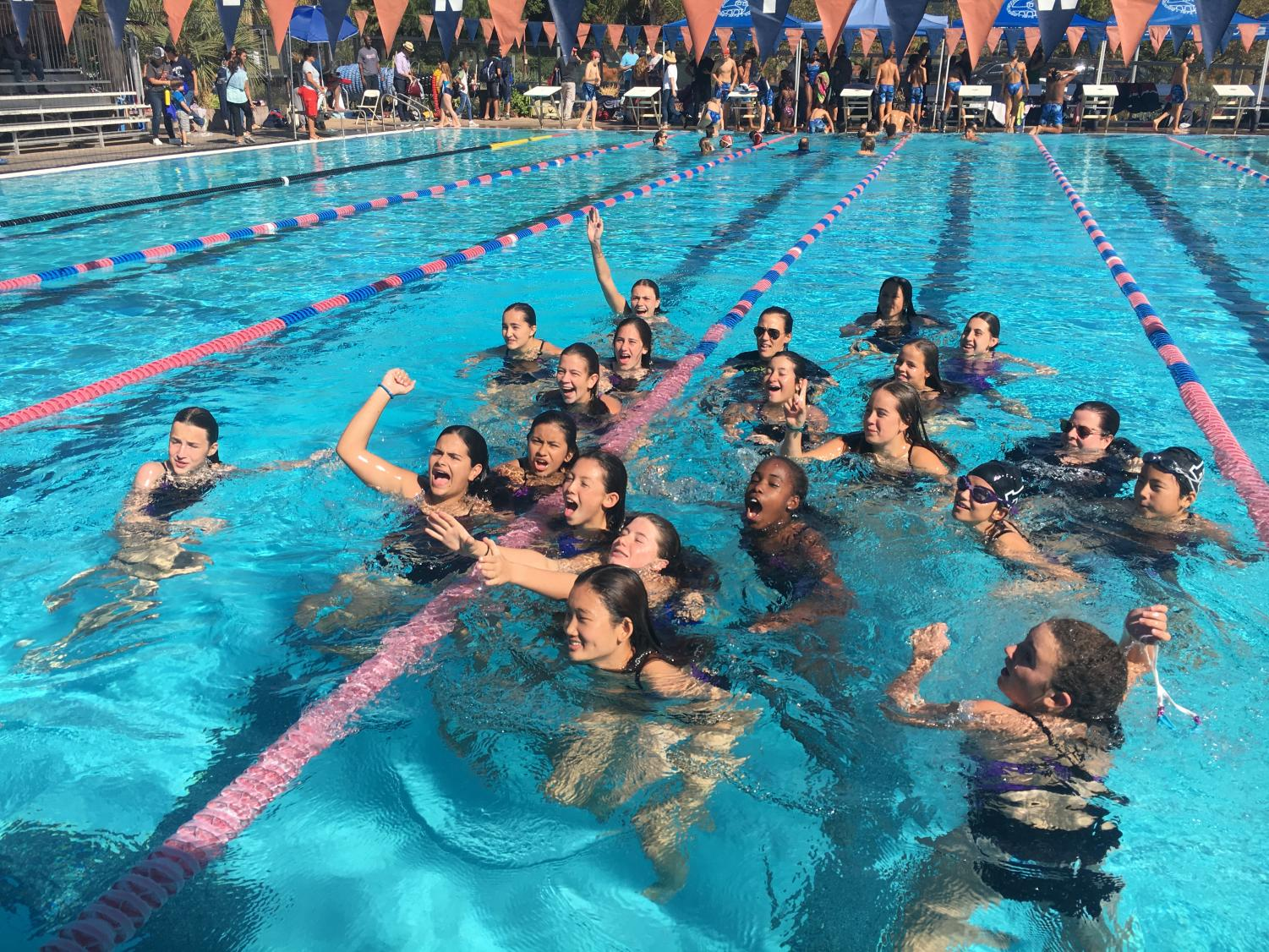 Archer's middle school swim team celebrates after winning the PBL championships at Brentwood school. The team won the PBL championship with 242 points.