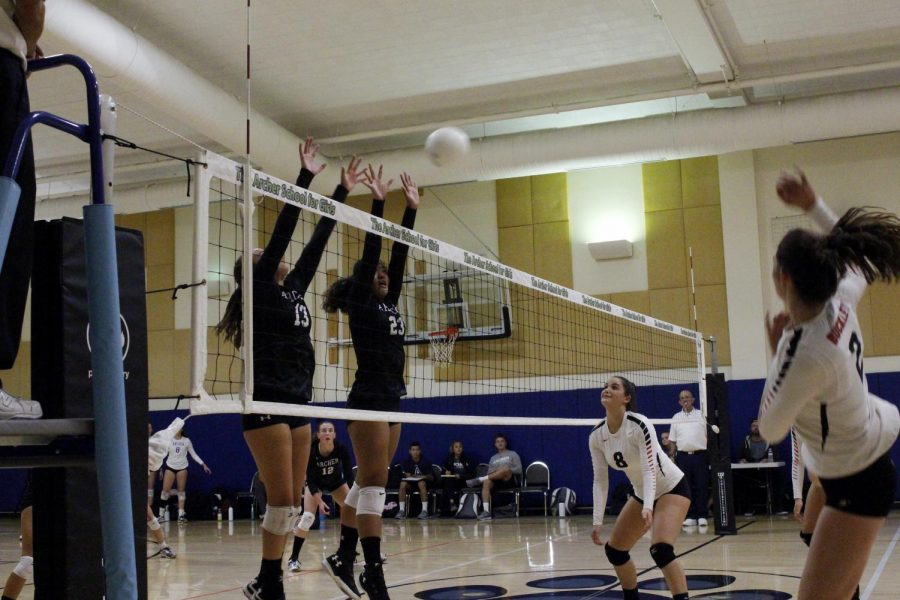 Vaughn+Anoa%27i+%2722+and+Bella+Morgan+%2721+block+the+ball+as+their+opponent+hits+it+over+the+net.+The+varsity+volleyball+team+will+move+on+to+the+next+round+of+CIF+playoffs+next+week.+