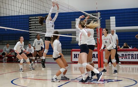 Sophomore Ava Salomon blocks a hit from Heritage. The team will play Beaumont High School this Saturday.