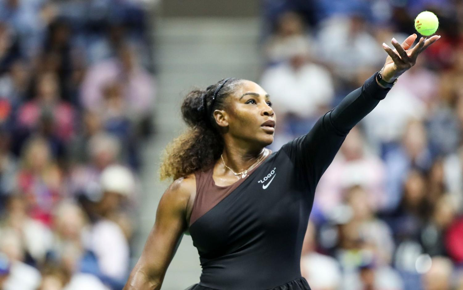 Serena Williams throws a ball before serving at the U.S. Open. Williams and the umpire argued multiple times throughout the match. Photo used with permission from David Shopland.