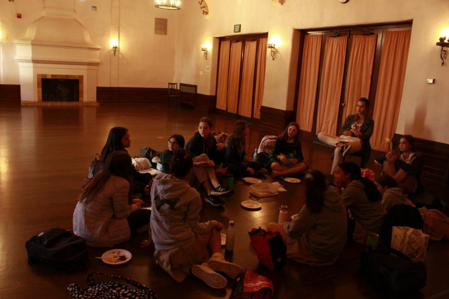 Eighth graders sit in the Rose Room during advisory. This year, the eighth grade has undertaken a new mentorship program, where they originally rotated between advisers.  Now, after recent changes, students will be staying with one adviser.
