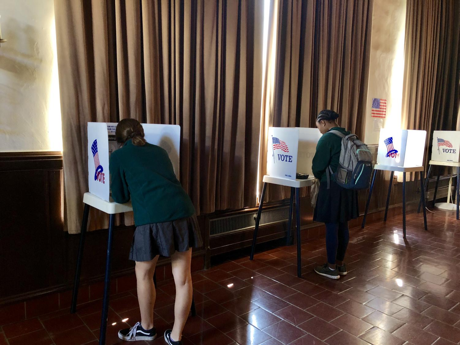 Aviva Intveld '19 and Lena Jones '20 cast their votes at today's mock election.  Students had the opportunity to learn about and vote on Proposition 10.