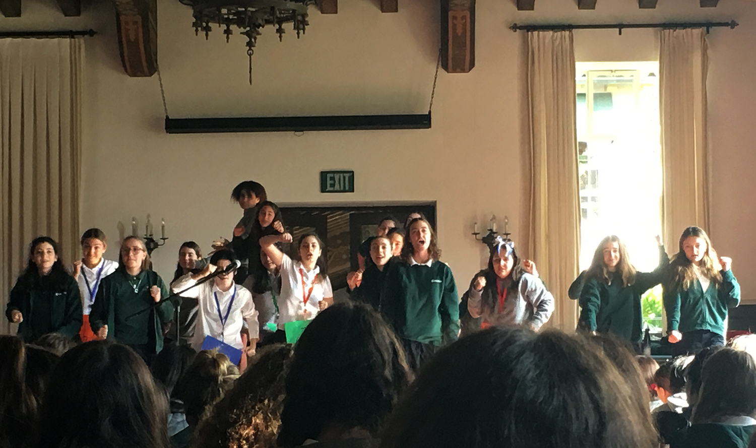 The musical cast sings a song to the upper school in the Dining Hall. The show will make its debut Dec. 8.