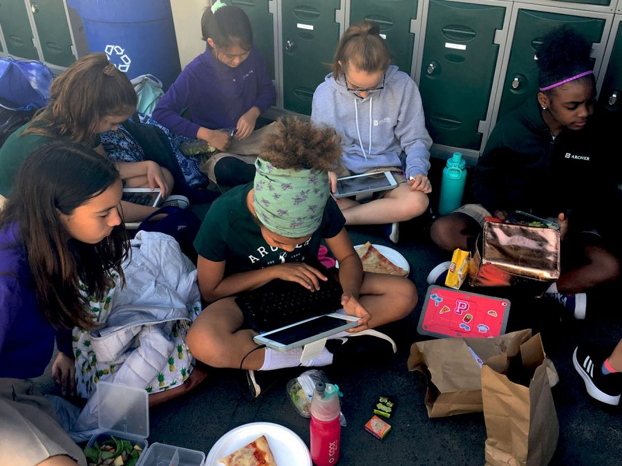 Sixth graders use iPads during lunch in the classroom village. Sixth graders started getting iPads during the 2016-2017 school year.