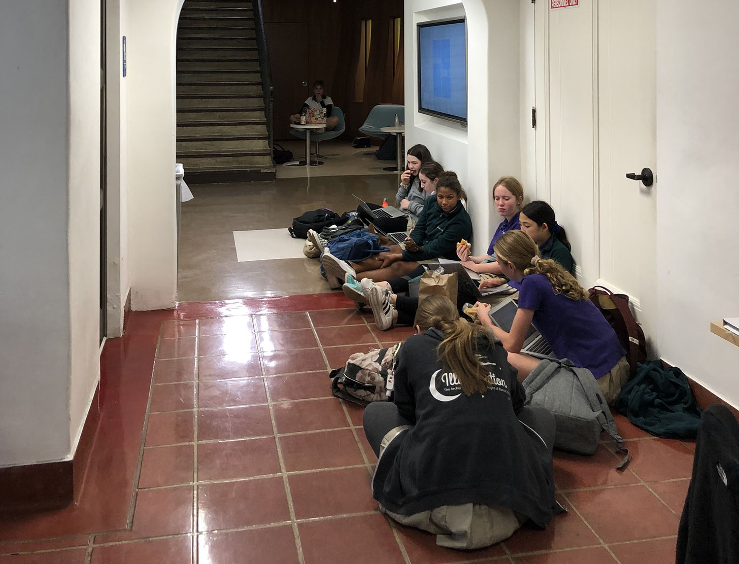 Archer students work in the hallway outside the library. The library has been closed for the past few days because a pipe burst.