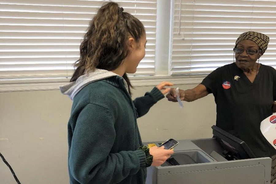 Shira Goldstein '19 receives a sticker after voting. Goldstein was among the Archer girls who headed to the polls on Tuesday, November 6. Photo courtesy of Goldstein