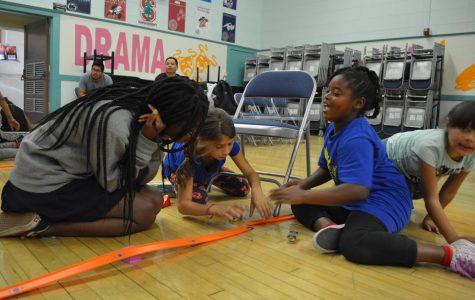 Victoria Pinkett '20 teaches kids at Brockton Avenue Elementary about kinetic and potential energy. The Mobile Science Camp club at Archer teaches hour-long science lessons at Brockton Ave. once a month.