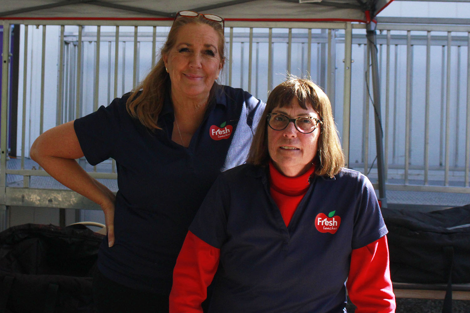 Nancy Eisenberg and Shari Dillon, two employees of FreshLunches, stand in the village during lunch.  Dillon has been working at FreshLunches for seven years and Eisenberg for four and a half.