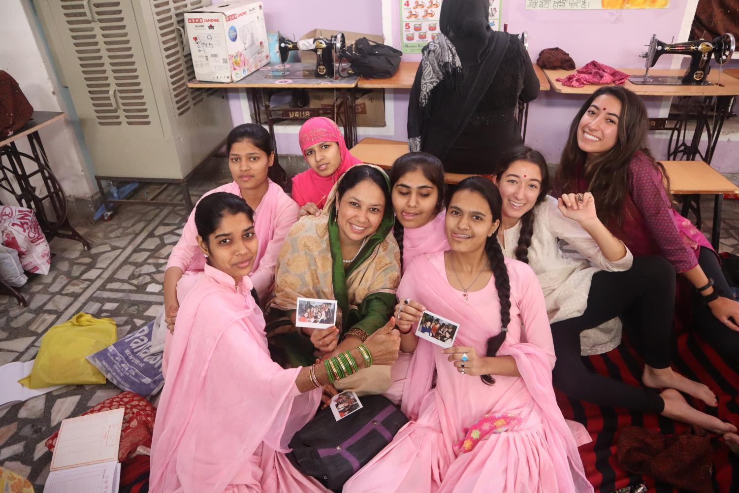 Juniors+Ariana+Golpa+and+Leila+Mirdamadi+pose+with+women+at+the+Sambhali+Trust+women%27s+empowerment+center.+The+Archer+girls+helped+with+administrative+work+at+the+organization.+