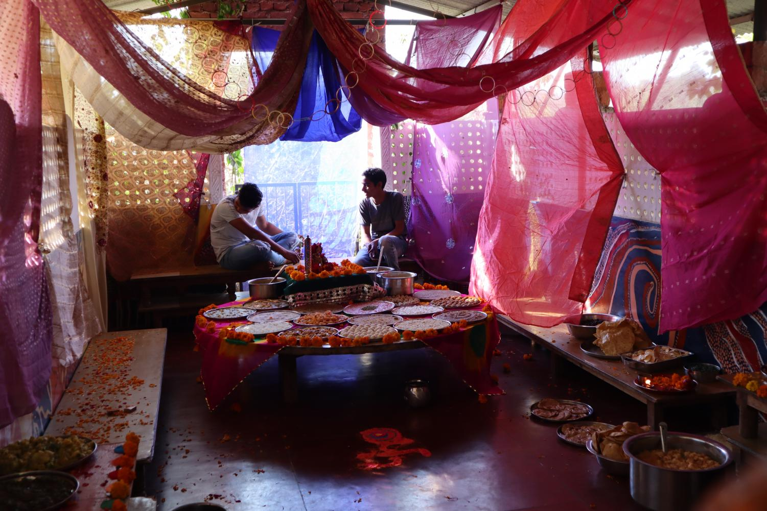 Students+at+Vatsalya+sit+in+a+room+covered+with+various+Colorful+fabrics.+Archer+has+worked+with+Vatsalya+for+around+two+years%2C+chaperone+Stefanie+Daehler+said.+