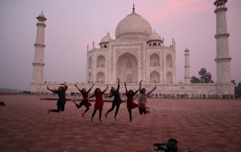 Six Archer students are captured jumping in front of the Taj Mahal at dusk.