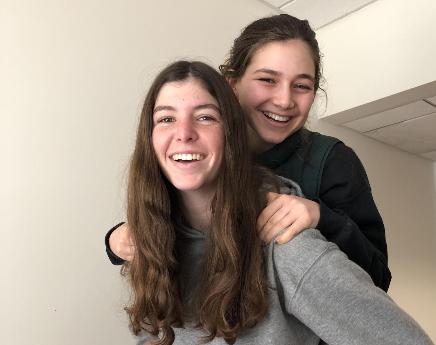 Senior equestrian captains Ella Frey and Maddy Benfield smile and pose together during x-block. This is the second year that the two girls are captains.