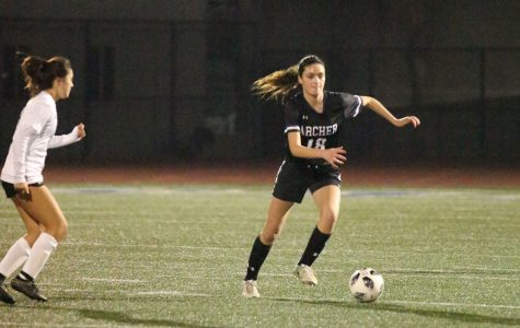 Junior Riley Adams dribbles the ball on the field at Santa Monica College. The team lost 2-0 to Pomona Catholic on Wednesday, Dec 11.