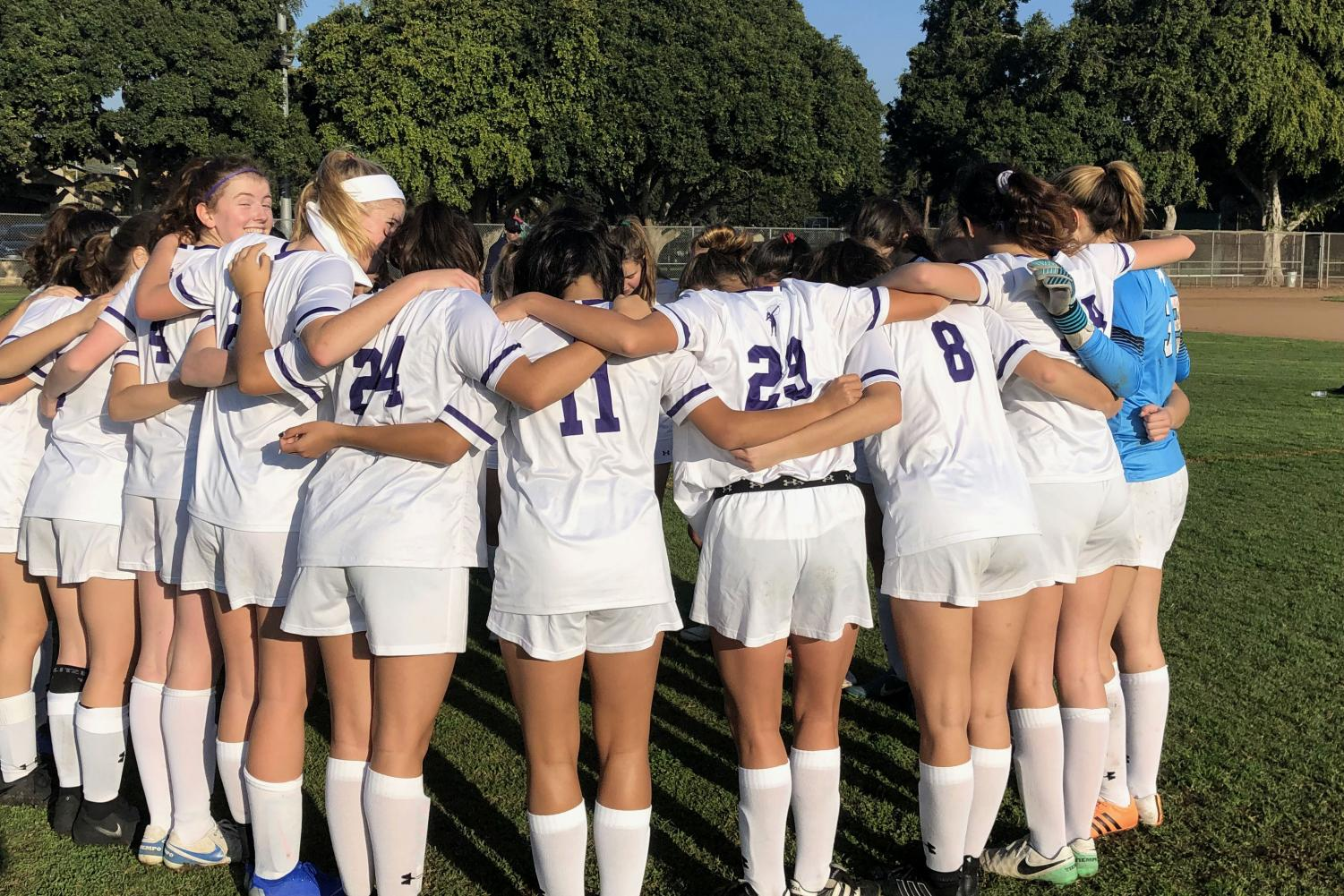 The Upper School varsity soccer team huddles up before today's game. The team won 3-0 against Pacifica Christian High School.