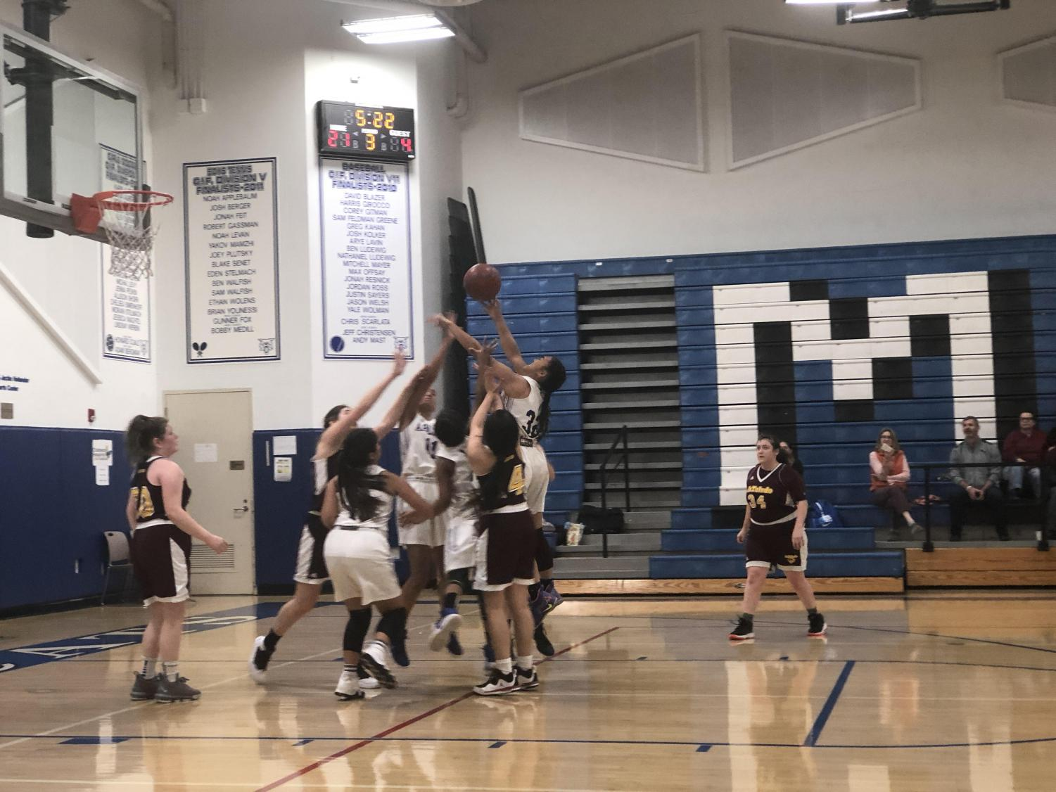 The varsity basketball team plays the de Toledo team at the Milken Classic Tournament on Dec. 4. Archer won the game 38-13.