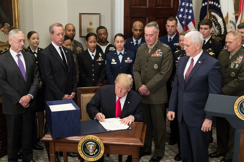 President+Donald+J.+Trump%2C+joined+by+Vice+President+Mike+Pence+and+senior+military+leaders%2C+signs+the+National+Defense+Authorization+Act+for+2018+on+Dec.+12%2C+2017.+Due+to+the+Government+Shutdown++many+United+States+agencies+were+without+funding+for+35+days.+