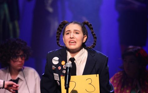 Spelling bee contestant Logainne Schwartzandgrubenierre, played by Willow Stein '22, prepares to compete. Upper school musical students performed