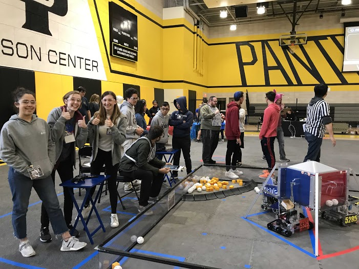 Emily Delossa '20, Marie Chorpita '19 and Ariel Heimanson '21 pose for a picture at a robotics competition. The team ranked third out of ten teams in the league during the meet.