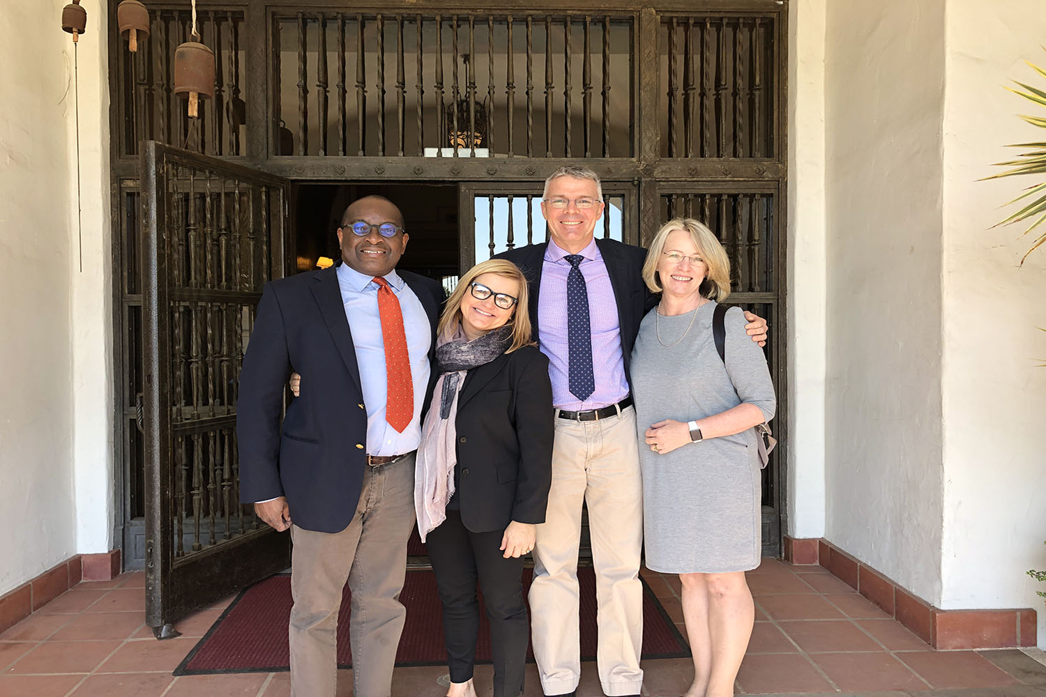 Members of the Independent Schools Association of Southern Africa pose with Assistant Head of School and Middle School Director Karen Pavliscak. The group was