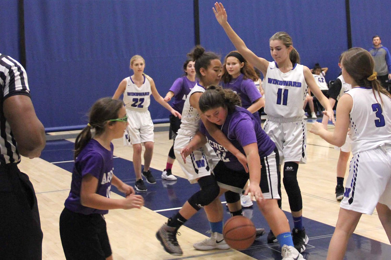 Captain Annabelle Terner '23 tries to keep the ball at a game against Windward School on December 18. Unlike past years, this season's team combines players from all middle school grades.